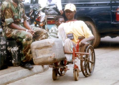 Fuel Scarcity,A physically challenged  in search of fuel,  at Obalende area of Lagos. Picture. PHOTO; Kehinde Gbadamosi