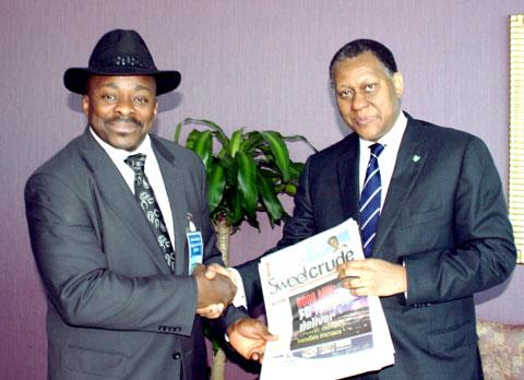 Mr. Odein Ajumogobia (r) receiving copies of Sweet crude from the editor, Hector Igbikiowubo on the sidelines of the 9th ministerial meeting of  Gas Exporting Countries Forum (GECF) in Doha, Qatar.