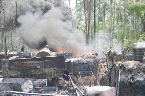 File photo: Illegal refineries being destroyed.
