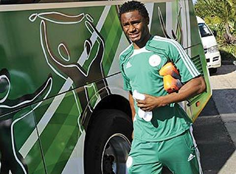 *Walking home - Mikel Obi walks towards the Nigerian bus in South Africa
