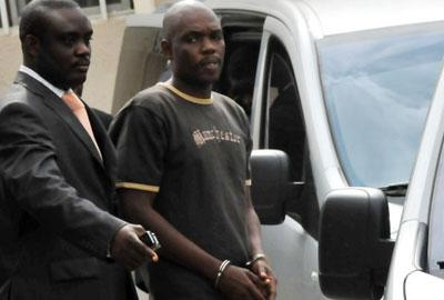 File photo: Charles Okah being led out of Abuja Court.