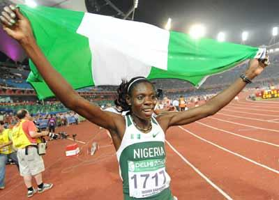 UP NIGERIA . . . Muizat Odumosu of Nigeria celebrates after the women's 400m hurdles final of Track and Field competition of the XIX Commonwealth Games Sunday in New Delhi. Odumosu won the women's 400m hurdles gold medal in a time of 55.28 seconds, Scotland's Eilidh Child came second (55.62) and Jamaica's Nickiesha Boden was third (56.06).Photo:  AFP
