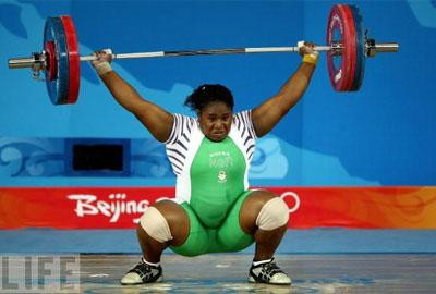 Mariam Usman of Nigeria competes in the women's +75kg group A weightlifting event at the Beijing University of Aeronautics & Astronautics Gymnasium at the Olympic Games in Beijing, China.