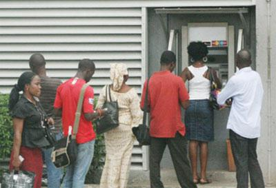 Users on queue at a bank's ATM