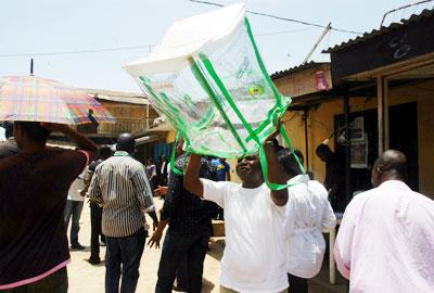 INEC official displays an empty ballot box