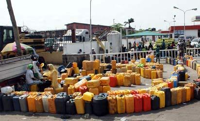 The struggle to buy Kerosene, an household commodity for cooking, becomes more challenging even at a NNPC petrol Station in Lagos. Photo by Lamidi Bamidele