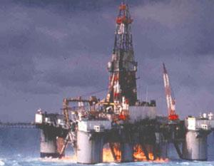 *Offshore oil rig on fire.