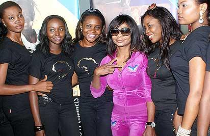 Karen Igho with event ushers at the airport.