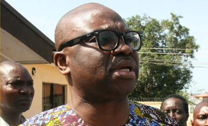 Former Ekiti State Governor, Mr. Ayo Fayose, outside the Federal High Court, Ado-Ekiti, after yesterday's sitting.