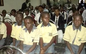 *School children listening attentively to instructions just before the poster contest commenced