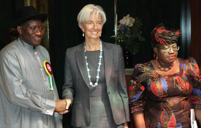 File Photo: International Monetary Fund (IMF) Managing Director, Christine Lagarde (C) shakes hand with President Jonathan after their meeting with Finance Minister Ngozi Okonjo-Iweala (R) in Abuja.