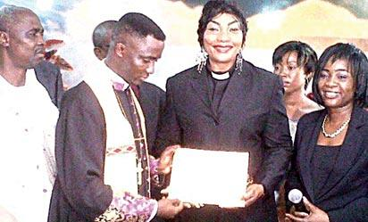 *Eucharia displaying her certificate after her ordnation