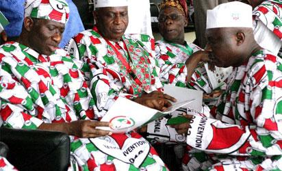 File photo: From Left, President Jonathan, Ag Chairman, Alhaji Abubakar Baraje, Former President and Bot Chairman, Chief Obasanjo and Chief of Staff to the President, Chief Ogiadomhe at the PDP convention