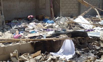 Shattered walls of Maiduguri bomb factory .