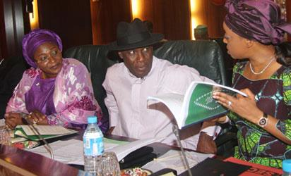 Petroleum Resources Minister, Mrs. Deziani Alison-Madueke (r) showing a copy of the authentic Petroleum Industry Bill to the Niger Delta Minister, Elder Godsday Orubebe and the Minister of State Niger DeltaDevelopment, Hajia Zainab Kuchi while the Sports Minister, Mr. Bolaji Abdullahi watched the weekly meeting of the Federal Executive Council at the State House, Abuja. Photo by Abayomi Adeshida