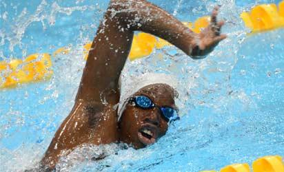 Togo's Adzo Kpossi 13 competes in the women's 50m freestyle heats during the swimming event at the London 2012 Olympic Games on August 3, 2012 in London.  AFP PHOTO