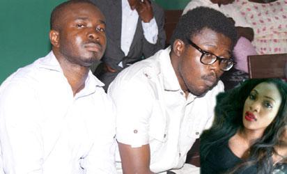 Okwumo Echezona Nwabufo (right) and Ezike Ilechukwu Olisaeloka, suspected murderers of Late Miss Cynthia Osokogu Udoka covering their faces at the Yaba Magistrate Court, Lagos yesterday. Photo: Lamidi Bamidele.