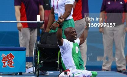 Yakubu Adesokan of Nigeria celebrates setting a new world record and gold in the Men's 48kg Powerlifting on day 1 of the London 2012 Paralympic Games at ExCel on August 30, 2012 in London, England.