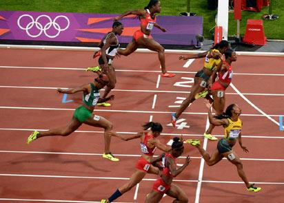 WINNER ... Jamaica's Shelly-Ann Fraser-Pryce crosses the finish line first ahead of others in the women's 100m final  on august 4 in london. AFP PHOTO