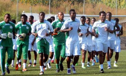 File Photo: JOGGING ••• Super Eagles players loosening up before training.