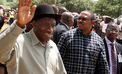 File photo: President, Dr Goodluck Jonathan with Gov. Obi of Anambra state acknowledging cheers from the people during his visit to sympathize with the people after the devastating flooding that hit  the state ...