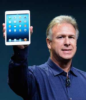 Apple Senior Vice President of Worldwide product marketing Phil Schiller announces the new iPad Mini during an Apple special event at the historic California Theater on October 23, 2012 in San Jose, California. The iPad Mini is Apple's smaller version of the iPad tablet.  AFP