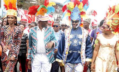 Former Miss Nigeria, Agbani Darego (left); Governor Rotimi Amaechi of Rivers State (second left); Deputy Governor, Tele Ikuru (second right) and deputy gov's wife, Mina, during the Garden City freestyle parade, in Port Harcourt.