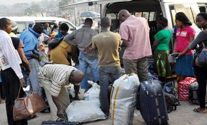 Commuters travelling out of Lagos at Ojota park, yesterday.