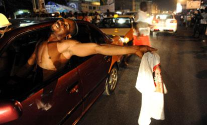 File photo: Supporters of the ruling National Democratic Party celebrate on December 9, 2012 in Accra the re-election of incumbent John Dramani Mahama .