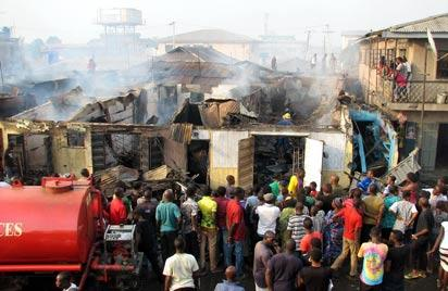 Sympathisers at the scene of the Ajegunle fire.