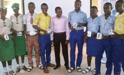 Winners displaying their Samsung Chief Hero mobile phones at the launch of Efiko, a mobile social quiz platform for secondary school students.
