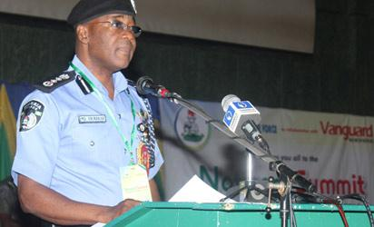 Inspector General of Police, Alhaji Mohammed Abubakar welcoming delegates to the official opening of the National Summit on Security Challenges in Nigeria at the official opening of the National Summit on Security Challenges in Nigeria held at the ICC, Abuja.  Photo by Abayomi Adeshida
