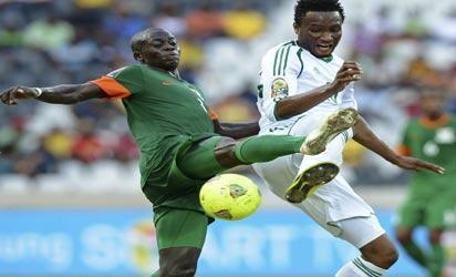 CRACKING... Nigeria's midfielder Mikel John Obi (R) vies with Zambia's midfielder Chisamba Lungu during  their  match yesterday at Mbombela Stadium in Nelspruit. AFP PHOTO