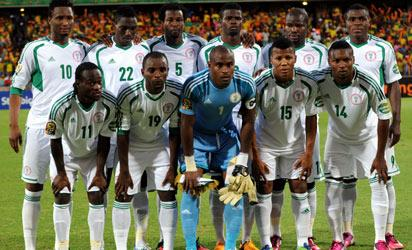 Nigeria's Team Photo Front Row: L-R: Midfielder Victor Moses, Forward Sunday Mba, Goalkeeper Vincent Enyeama,  Forward Ikechukwu Uche,  Defender Godfrey Oboabona. Back row L-R: Midfielder John Obi Mikel, Defender Kenneth Omeruo,Defender Efe Ambrose,  Forward Emmanuel Emenike, Defender Elderson Echiejile, Forward Emmanuel Emenike,   during a 2013 African Cup of Nations Group C match in Rustenburg on January 29, 2013 at Royal Bafokeng Stadium. AFP PHOTO