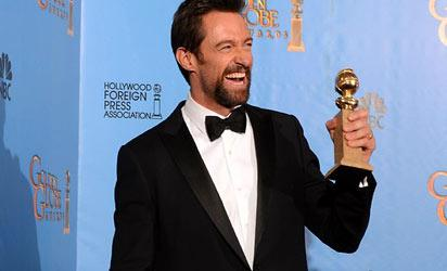 Hugh Jackman poses in the press room with his Golden Globe. Picture: AFP