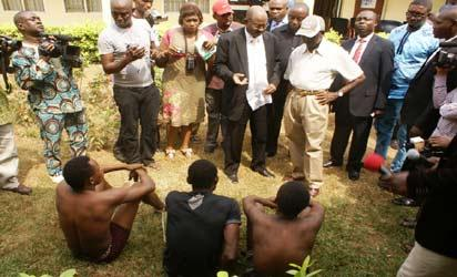 *Suspected Kidnappers on Parade: From right: Governor Adams Oshiomhole of Edo State; Mr. Tukur Bakori, Director of DSS, Edo State, and journalists during the parade of suspected kidnappers in Benin City, Edo State. Photo: Barnabas Uzosike.