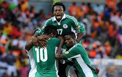 Nigeria's forward Sunday Mba (hidden) is congratulated by teammates after scoring a goal during the African Cup of Nation 2013 quarter final football match Ivory Coast vs Nigeria, on February 3, 2013 in Rustenburg. AFP PHOTO / ALEXANDER JOE