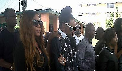 Goldie's funeral procession ... Denrele; Goldie's best friend