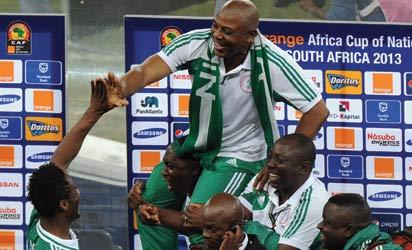 Champion ..... Eagles lift their  Coach Stephen Keshi after the team won the Cup yesterday. Photo: AFP