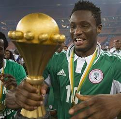 Mikel with the Afcon trophy