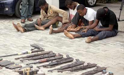 Some suspected robbers and their weapons as paraded by the Rivers State Police in Port Harcourt. Photo: Nwankpa Chijioke.