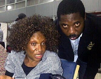 Ngozi at the airport Tuesday night with her publicist Seun Oloketuyi