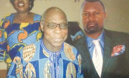 The suspect, in another super-imposed picture with former President Obasanjo