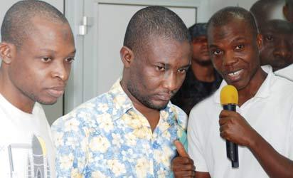 Suspected TerroristS— From Left: Saheed Aderemi Adewumi and Sulaiman Olayinka Saka recruited by Abdullahi Mustapha Berende (right), paraded by the Department of State Security  in Abuja, yesterday.  Photos: Gbemiga Olamikan.