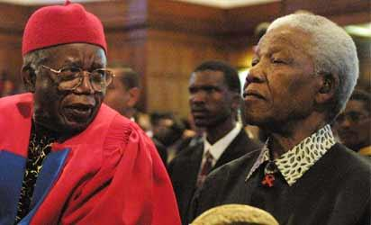 "Acclaimed Nigerian author Chinua Achebe (L) and former South African President Nelson Mandela chat on September 12, 2002 prior to Achebe receiving an honorary degree of Doctor of Literature and delivering the third Steve Biko Memorial Lecture at the University of Cape Town.  Nigerian novelist Chinua Achebe, the revered author of ""Things Fall Apart"" who has been called the father of modern African literature, has died aged 82, his publisher said on March 22, 2013.   AFP PHOTO"