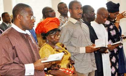 President Goodluck Jonathan (l) singing a hymn with his mum, Mama Eunice Jonathan; Executive Secretary Christian Pilgrims Commission, Mr. John Kennedy Opara and other worshipers during a Church service to mark the Good Friday at the Aso Villa Chapel, State House, Abuja. Photo by Abayomi Adeshida