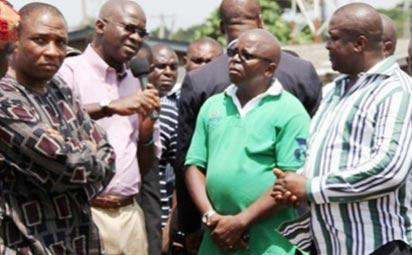 The Ladipo International Auto Spare Parts Market during the visit of Governor Babatunde Fashola, yesterday. INSET: Lagos State Governor, Mr Babatunde Fashola (middle); Commissioner for Environment, Mr. Tunji Bello (left); Director of Enforcement, Ministry of the Environment, Oluwatoyin Adesina Onisarotu (2nd right); Chairman, Mushin Local Government Area, Mr. Babatunde Adepitan (2nd left) and President General, Ladipo Central Executive Auto Dealers Association, Comrade Ikechukwu Animalu.