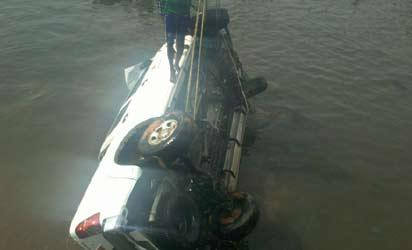 The ill-fated vehicle being pulled out of the river.