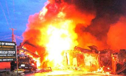 A building burning after a fuel-laden tanker caught fire on Atowoda Street at Inalende in Ibadan, Monday night. Photo: Dare Fasube.