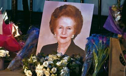 """Flowers and mementos left by members of the public and admirers sit outside the home of former British Prime Minister Margaret Thatcher in central London on April 8th 2013. Former British prime minister Margaret Thatcher, the """"Iron Lady"""" who shaped a generation of British politics, died following a stroke on April 8, 2013 at the age of 87, her spokesman said. AFP PHOTO"""